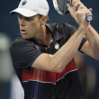 Sam Querrey backhands his return during the game — ストック写真