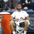 Benoit Paire takes a break during the game - Stock Photo