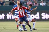 Dario Delgado dribbles away from FC Dallas Daniel Hernandez and FC Dallas David Ferreira during the game — Stock Photo