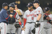 Most of the Nationals infield have a quick meeting at the mound during the game — Stock Photo