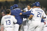 James Loney gets rushed by teammates after batting in the winning run of the game — Stock Photo