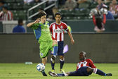 Michael Lahoud tries to poke the ball away from Alvaro Fernandez during the game — Stock Photo