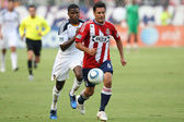 Edson Buddle chases down Chivas USA defender Ante Jazic during the game — Stok fotoğraf
