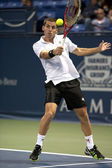 Flavio Cipolla returns a serve to Jack Sock during the tennis match — Stock Photo