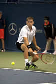 Flavio Cipolla reaches with backhand to Jack Sock during the tennis match — Stock Photo