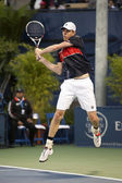 Sam Querrey gets airborne with his backhand during the game — Stock Photo