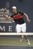 Sam Querrey charges the net during the game — Stock Photo