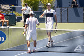 Ricardas Berankis and Sam Querrey shake hands during the game — Stock Photo