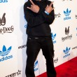 Постер, плакат: Darryl D M C McDaniels arrives at the NBA All Star Weekend VIP party co hosted by Adidas and Snoop Dogg
