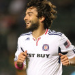 Постер, плакат: Baggio Husidic smiles after scoring during the game