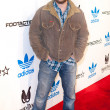 Постер, плакат: Actor Richard Steidt arrives at the NBA All Star Weekend VIP party co hosted by Adidas and Snoop Dogg