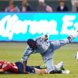 C.J. Sapong and Jimmy Conrad  get tripped up during the game - Stock Photo