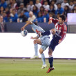 Stock Photo: Heath Pearce and Omar Bravo in action during game