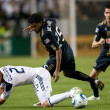 Постер, плакат: Todd Dunivant gets tripped up during the game
