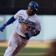 Stock Photo: Matt Kemp rounds thrid on his way home during game