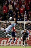 Kei Kamara and Zarek Valentin jump for a header during the game — Stock Photo
