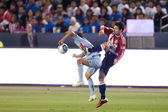 Heath Pearce and Omar Bravo in action during the game — Stock Photo