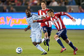 C.J. Sapong gets chased down by Zarek Valentin and Ben Zemanski during the game — Stock Photo