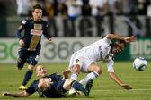 Jordan Harvey slide tackles Juninho during the game — Stock Photo