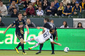 Landon Donovan gets taken down by Danny Califf during the game — Stock Photo