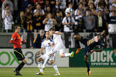 Danny Mwanga, Todd Dunivant and Landon Donovan in action during the game between the Philadelphia Union and the Los Angeles Galaxy at the Home Depot Center — Stock Photo
