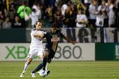 Landon Donovan and Sheanon Williams in action during the Major League Soccer game — Stock Photo