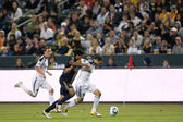 Landon Donovan tries to hold of Sheanon Williams during the game — Stock Photo
