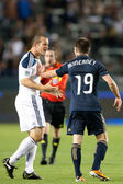 Chad Barrett gets into a shoving match with Jack McInerney during the game between the Philadelphia Union and the Los Angeles Galaxy at the Home Depot Center — Stock Photo