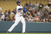 Juan Uribe fields a ground ball and throws to first for the out during the game — Stock Photo