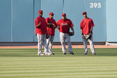 Some of the Diamondbacks hang out in the outfield before the start of the game — Stock Photo