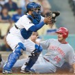 Stock Photo: Dioner Navarro and Cincinnati Reds left fielder Chris Heisey in action during the