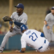 Matt Kemp gets by San Diego Padres second baseman Orlando Hudson to steal second during the game - Stock Photo