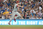 Chase Utley throws to first for the out during the game — Stockfoto