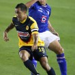 Stock Photo: Daniel Montenegro gets past Cruz Azul ChristiGimenez during game