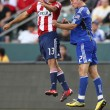 Постер, плакат: Jonathan Bornstein and Michael Harrington fight for a header during the game