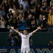 Постер, плакат: Robbie Keane celebrates his first goal during his debut with the Galaxy during the game
