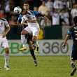 Juninho and Chris Wondolowski in action during the game — ストック写真
