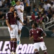 Omar Gonzalez and Caleb Folan fight for a header during the game — Stok fotoğraf