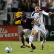 Постер, плакат: Marvell Wynne and David Beckham in action during the game
