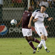Постер, плакат: Marvell Wynne and Robbie Keane fight for the ball during the game