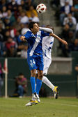 Jonathan Lopez and Brayan Beckeles fight for a header during the game — Stock Photo