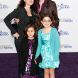 JANE LYNCH, DR. LARA EMBRY, and children arrive at the Paramount Pictures Justin Bieber: Never Say Never premiere - Stock Photo