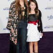 Постер, плакат: MILEY CYRUS and NOAH CYRUS arrive at the Paramount Pictures Justin Bieber: Never Say Never premiere