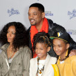Постер, плакат: WILL SMITH JADA PINKETT SMITH JADEN SMITH and WILLOW SMITH arrive at the Paramount Pictures Justin Bieber: Never Say Never premiere