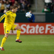 Постер, плакат: Robbie Rogers controls the ball during the game