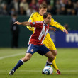 Nick La Brocca and Robbie Rogers fight for the ball during the Major League Soccer game — Stock Photo