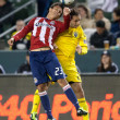 Marcos Mondaini and Sebastian Miranda fight for the ball during the game - Stock Photo