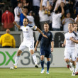 Landon Donovan celebrates after scoring on a penalty kick during the game - Stock Photo