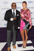 L.A. REID and wife ERICA HOLTON arrive at the Justin Bieber: Never Say Never premiere — Stock Photo