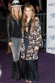 MILEY CYRUS and TISH CYRUS arrive at the Paramount Pictures Justin Bieber: Never Say Never premiere — Stock Photo